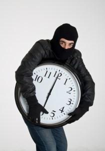 Thief stealing clock