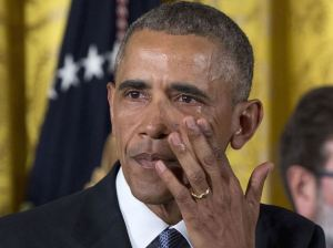 Obama tears up over gun control