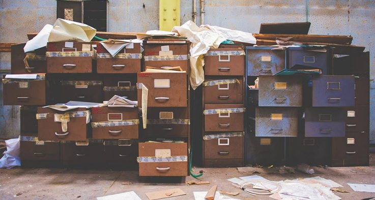 Cleaning closet file cabinets papers