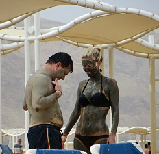 People slathering themselves with Dead Sea mud, Isreal