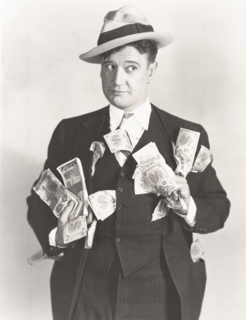 Vintage black and white photo of man holding lots of cash to anticipate a Coronavirus and protect his nest-egg