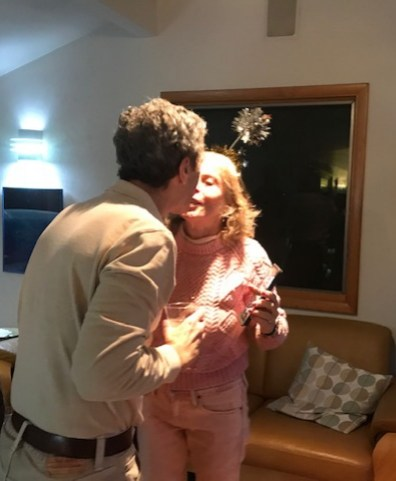 LV and Charlie kissing on New Year's Eve just before rebalancing their portfolio.