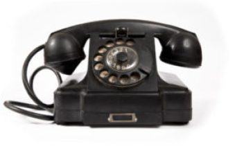 Vintage black and white photo of rotary dial phone