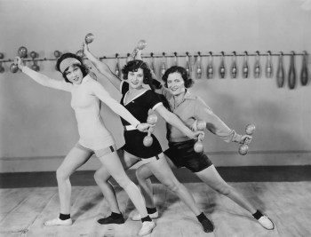Vintage black and white photo of three women lifting weights in a continuing care retirement community