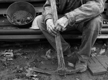 part of picture showing an impoverished coal miner