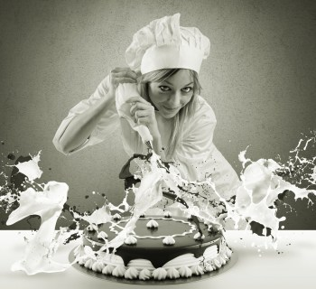 Female chef baking cake