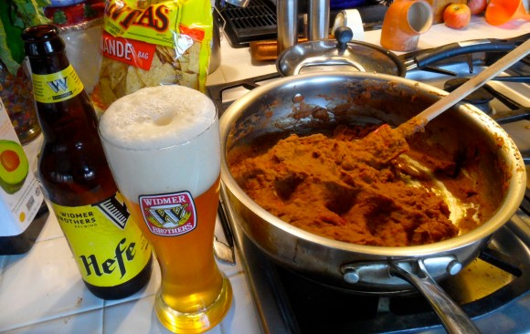 The perfect match of beer, beer glass, and habanero bean dip.