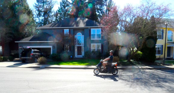 """A couple peering through their window. """"Great. A biker gang. There goes the neighborhood."""
