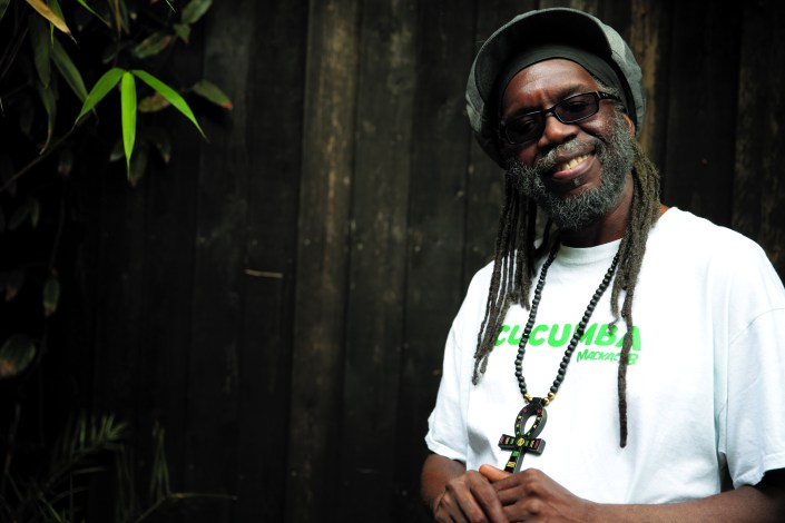 Macka B's words, sound and power was forged in the red hot heat of UK sound-system culture. Inspired by H.I.M. Ras Tafari and pioneer DJ's such as U-Roy, I-Roy, Big Youth, his lyrical flow for Wassifa Hi-Fi at a now legendary London/Brum clash with Saxon caught the ears of Fashion Records who brought him down to London faster than HS2* to record his solo debut 'Bible Reader'. A link up with up Mad Professor followed leading to a string of hit albums and singles for Ariwa and an extensive tour schedule increasing Macka's international profile while delivering a crossover chart in Hawaii with 'Bob'. Over the years Macka has collaborated with a veritable who's who of dynamic talent including Horace Andy, Baaba Maal, Freddie McGregor, Steel Pulse, Luciano and Gregory Isaacs while sharing the stage with a whole heap of legendary reggae icons. In 2015 Macka B released the Peckings Brothers produced album 'Never Played A 45' which, as well as the in-demand title track, featured 'Medical Marijuana Card' the animated video of which amassed over 600,000 YouTube views. Now teaming up with Greensleeves records Macka B delivers 'Health Is Wealth' a highly anticipated album including the viral hit, 'Cucumba'. The video has amassed over 43 million views so far on UNILAD's Facebook page https://www.facebook.com/UNILADSound/videos/428506530826328/?autoplay_reason= all_page_organic_allowed&video_container_type=0&video_creator_product_type=2&ap p_id=2392950137&live_video_guests=0 'Cucumba' has received Breakfast show support in the UK by Nick Grimshaw on BBC Radio One, in NYC by Ebro on Hot 97FM and LA by BigBoy on iHeart Real 92.3. This has resulted in guest spots on BBC Radio 4, BBC Radio 5, BBC World Service & BBC Radio London, plus UK national press in the Daily Mail Newspaper. http://www.dailymail.co.uk/femail/article-4321476/Reggae-artist-goes-viral-freestyleCUCUMBERS.html Reflecting Macka B's world-wide fanbase 'Health Is Wealth' features tracks produced in Jamaica, Germany & J