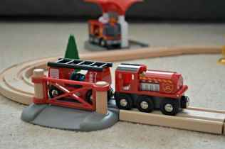 brio-firefighter-set-railway-crossing-and-fire-train-with-hose-truck