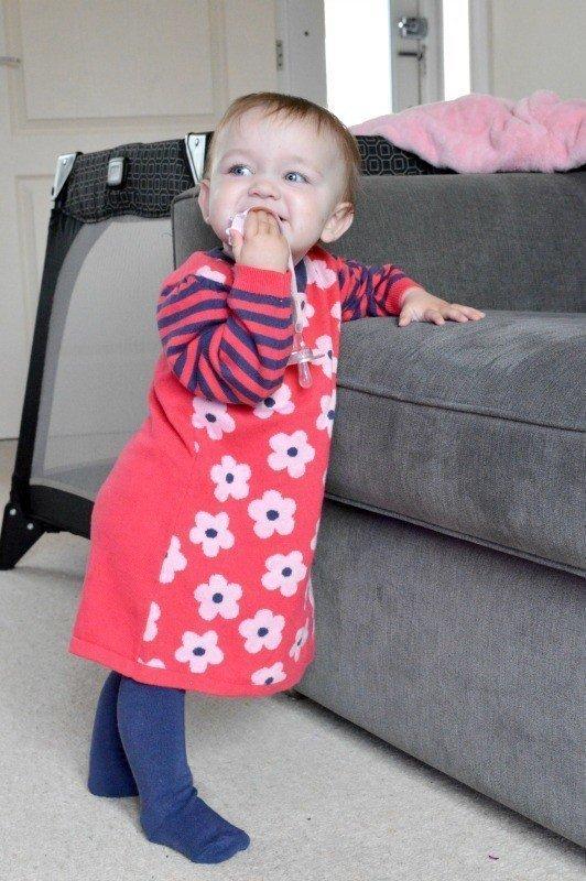 nutmeg-baby-knitted-dress-piglet-standing