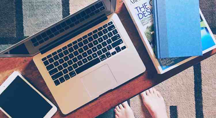 side hustle with laptop and books