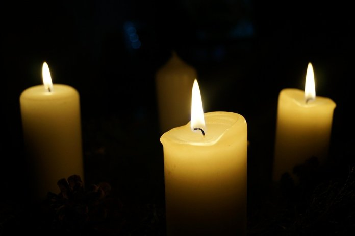 3 candles lit on advent wreath