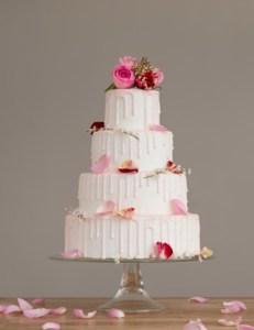 Pastel pink drip wedding cake
