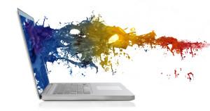 Farben spritzen aus einem Laptop
