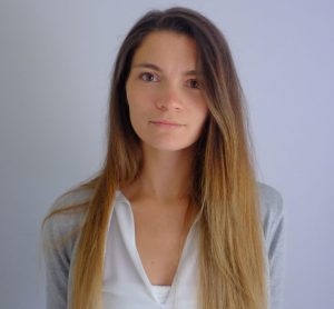 A photo of Amy Cheskin. She has very long brown hair that turns blonde near the ends and a heart shaped face.