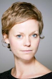 A photo of Rachel Drazek. She has very short brown hair and blue eyes.