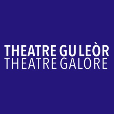 Theatre Gu Leor logo: White capital letters saying Theatre Gu Leor (gaellic), and then below it Theatre Galore (englins), set on a dark blue background.
