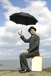 Man sitting under an umbrella