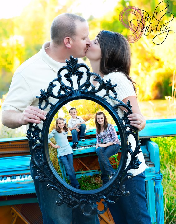 This Kiss A picture within a picture, displaying their pride and joy. PINK PAISLEY PHOTOGRAPHY