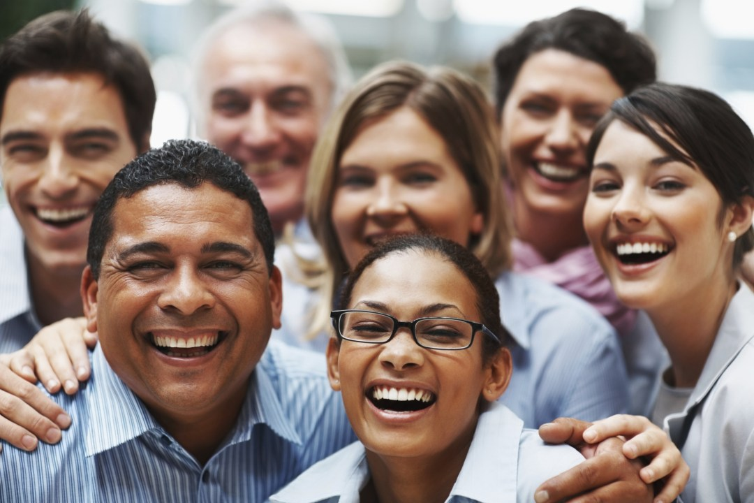 Successful diverse business team laughing together