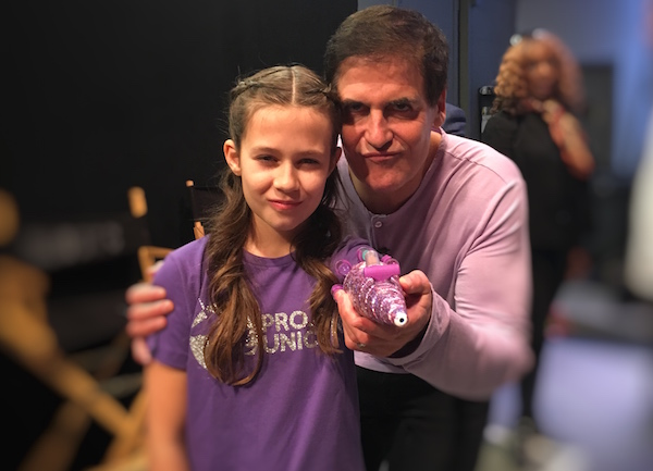 Jordan and Mark Cuban look at the camera with a tough look while Jordan holds up Project Unicorn.