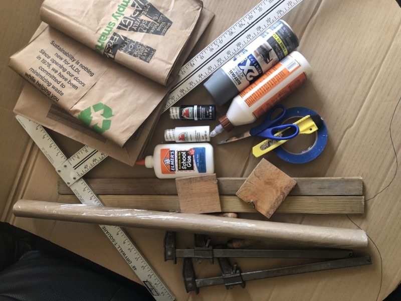 Paper bags, spray paints, t-square, elmers glue, wood glue, sissors, box cutter, clamps, craft paint, painters tape, dollar store packaging paper,wood pieces for clamping, and clamps