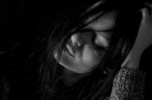 Depressed girl with long hair