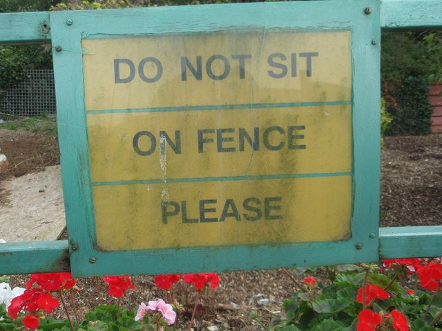 No Fence Sitting sign