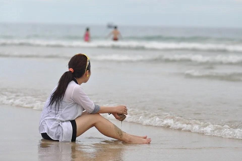 Sad girl on beach