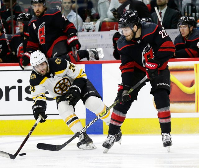 Boston Bruins Jake Debrusk 74 And Carolina Hurricanes Brett Pesce 22 Skate During The First Period In Game 3 Of The Nhl Hockey Stanley Cup Eastern