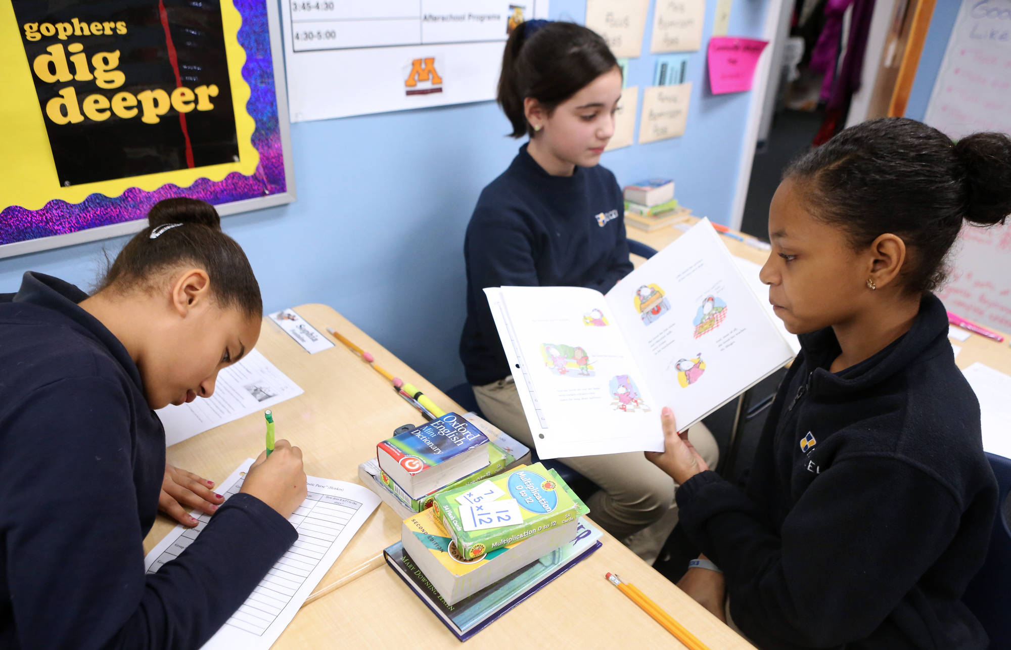 Gianna federico and ilianny mora rosa work together to identify imagery in  story during class at excel academy orient heights wednesday also heslam charter trio helps local pupils  boston herald rh bostonherald