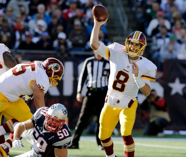 Washington Redskins Quarterback Kirk Cousins  Passes Over New England Patriots Defensive End Rob Ninkovich  During The First Half Of An Nfl Football