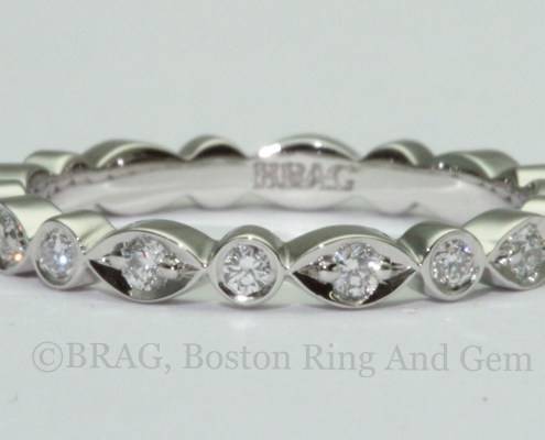 Round and marquise alternating Platinum and diamond eternity wedding ring