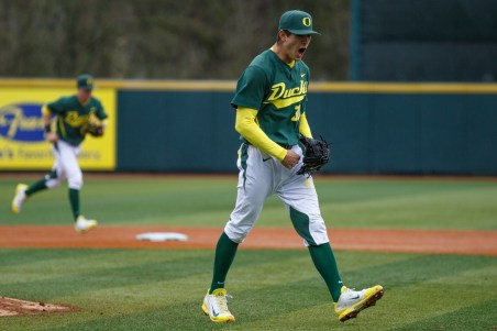 Oregon pitcher Stephen Nogosek (30) pumps his fist as he strikes out Titans outfielder Austin Diemer (22) for the final out of the sixth inning. The Oregon Ducks play the Cal State Fullerton Titans at PK Park in Eugene, Ore., on Mar. 2, 2014. (Michael Shaw/Emerald)