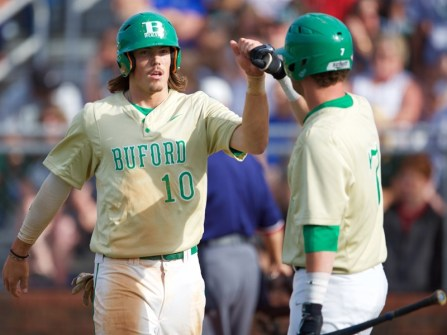 Marsh and teammate Griffin Joliff celebrating after scoring two runs