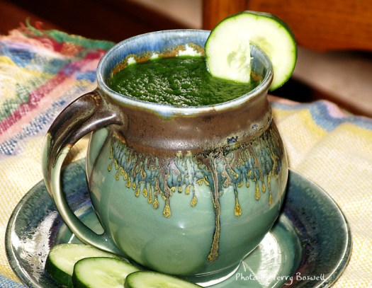 Green smoothie in a celedon green mug made on the potter's wheel by Andy Boswell