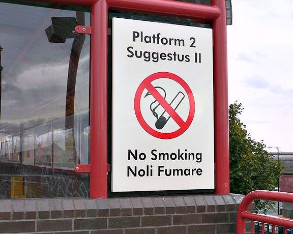 "One of the bilingual English and Latin signs at Wallsend Tyne and Wear Metro station. It reads ""Platform 2 / Suggestus II / No Smoking / Noli Fumare""."