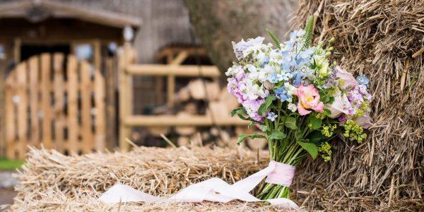Wedding flowers on bale of hay