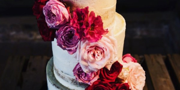 Buttercream wedding cake with red roses