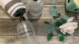 Flat lay clear shampoo and conditioner set
