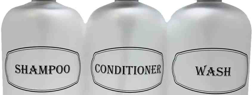 Clear shampoo, conditioner, wash bottles w black print and black pumps