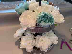tiered tray with accent color flowers placed