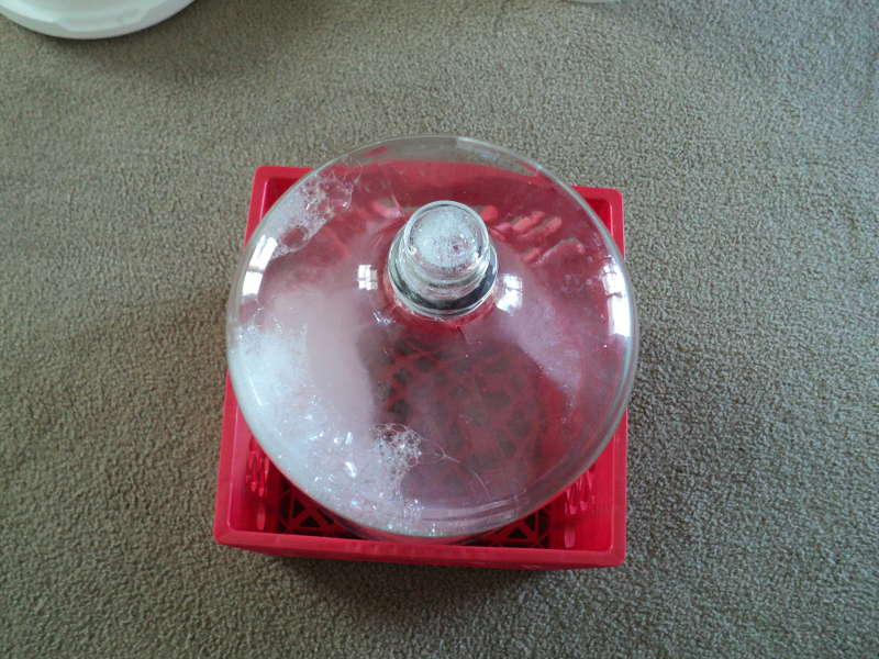 milk crate with a 6 and a half gallon glass carboy