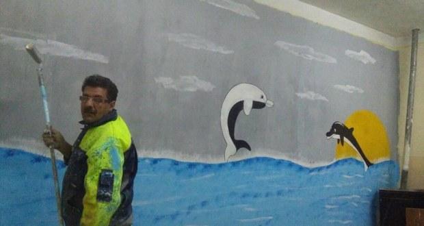 ريشة محمد ديبش على جدران مؤسسة تعليمية ببوسعادة