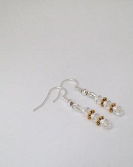 Boucles d'oreilles transparentes et or
