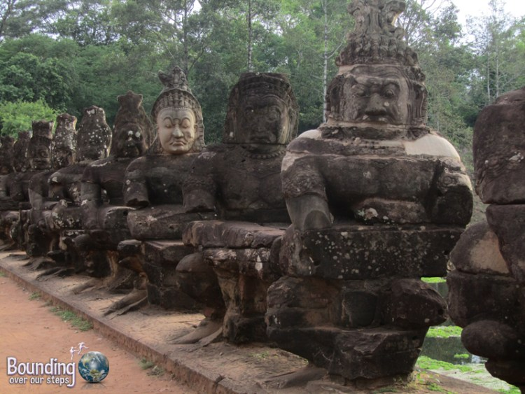 Statues along the bridge to Bayon Temple among Angkor Wat, Cambodia