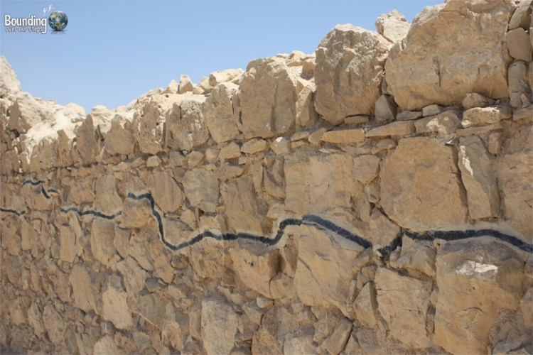 A line in the stones of Masada show where the ruins have been reconstructed