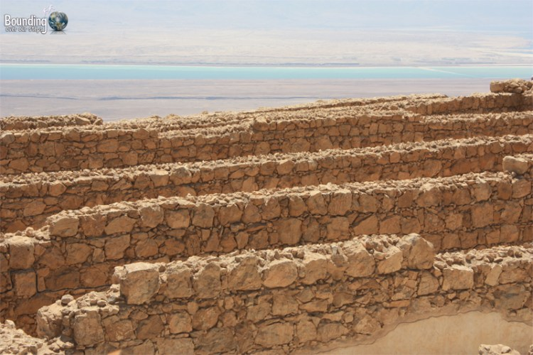 The Dead Sea in the distance behind the ruins of Masada