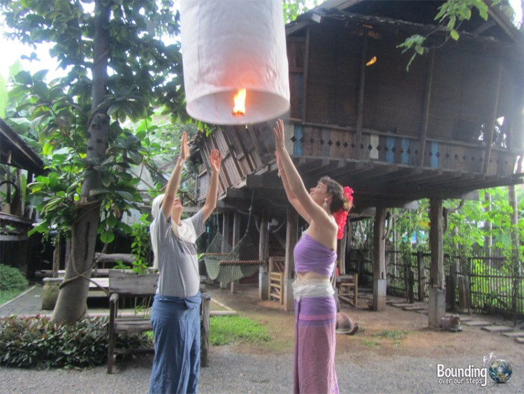 Releasing a sky lantern and making a wish in Chiang Mai, Thailand